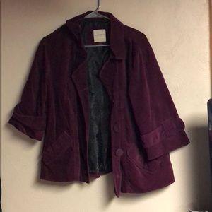 Deep red crushed velvet jacket.